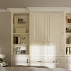 master bedroom built in niche | Bedroom built-in media cabinet with bookcase.