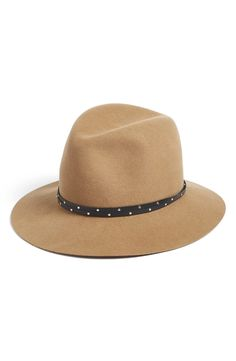 Absolutely loving this floppy-brimmed fedora crafted in rich felted wool. It will be the perfect accessory to any fall look.
