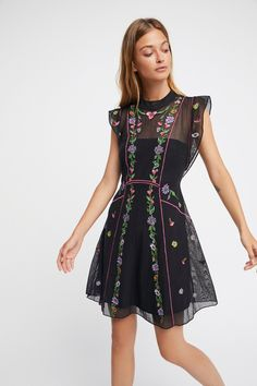 Riviera Mini Dress   Pretty and femme, this mini dress features delicate floral embroidery on a sheer design with a partial lining.    * Hidden side zipper closure   * Ruffled cap sleeves