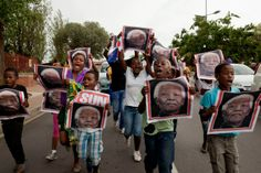 Dec. 6, 2013. Children react to the death of Nelson Mandela on the streets outside of his former home in Soweto, South Africa.
