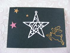 voorkant dubbele groene kaart met stans(ster) en stickers