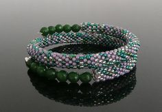Beautiful Modern Stylish Purple Green Silver Bead Crochet Green Onyx Gemstones Memory Wire Bracelet. I am sure it will be one of your favorite.