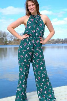 Floral print sleeveless jumpsuit Bow tie around neck Stretch band at waistline rayon Daniel Jumpsuit Outfit, Floral Jumpsuit, Neck Stretches, Cool Style, My Style, Stretch Bands, Online Clothing Boutiques, Fashion Boutique, Floral Prints