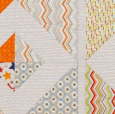 Natalia Bonner machine-quilted horizontal wavy lines with occasional circles across the quilt top.