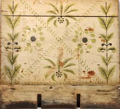 Fireboard, ca. 1820. Stenciled flowers and leaves on this fireboard