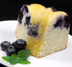 This is a quick lemon cake that benefits from the lovely addition of blueberries. You could leave out the berries if you're after a classic lemon drizzle cake, though the blueberries are heavenly! Lemon Blueberry Pound Cake, Lemon Loaf Cake, Lemon Drizzle Cake, Bundt Cake Mix Recipe, Cake Mix Recipes, Cake Mixture, Moist Cakes, Sweet Recipes, Healthy Recipes