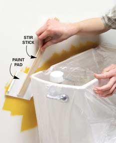 {Long reach paint pad keeps tight spots neat}... If you have a tight spot to paint, remove the pad from a paint edging tool (about $2 at home centers). Hot-glue the pad to a stir stick, and you've got a painting tool that will fit behind toilet tanks and radiators.