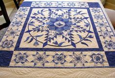 Blue/white feathered star Quilt by millicent