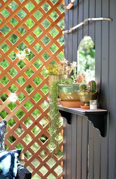 We love this lattice privacy screen and all the succulents on this gorgeous patio. It's part of a total patio makeover by Shavonda Gardner of SG Style for The Home Depot's Patio Style Challenge. See it on The Home Depot Blog.