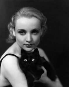 Carole Lombard and lovely feline friend. 1930. Photographer: Unknown.