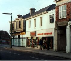 A similar view to that of circa 1920, but just prior to demolition in 1984 Both these buildings were erected on the former site of Toll-bar Cottage owned by John Lucas (see B4.3) and were both shops by the early 20th century and remained as such until their demolition in 1984 for road widening.