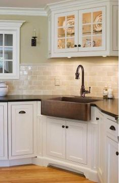 """This sink """"definitely has presence"""" according to one happy customer who bought this hammered copper farmhouse sink by Ecosinks."""
