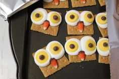 owls    marshmallows....yellow candy melts...put marshmallow and candy melt on cracker and microwave for 2-5 seconds.....put chip and corn pieces on while warm
