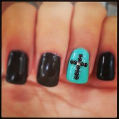 Black, turquoise, cross nails. I would definitley wear these(: