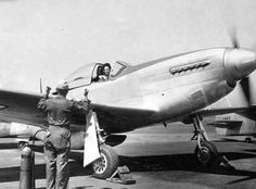 Florene Watson preparing a P-51D-5NA for a ferry flight from the factory at Inglewood, California.