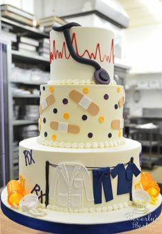 Med School Graduation Cake by Beverly's Best Bakery. Might make this for my sisters graduating from college to b a nurse