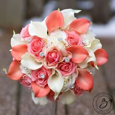"""""""Coral and Cream Dream 2.0"""" Cream and Coral wedding bouquet with Real Touch calla lilies, two types of real touch rose, and sparkly gem accents  This bouquet is a beautiful and blingy version of one of our most popular styles, Coral and Cream Dream. Hand wired gems are placed meticulously throughout the bouquet to achieve balance and elegance. Real Touch Calla lilies and roses look and feel so real you will have your guests wondering how your bouquet didnt wilt all day. Handle partially…"""