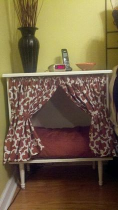 Nightstand dog bed.. I already have a great night stand where I have a bed for Scratchy.   Maybe I can make it more like this!
