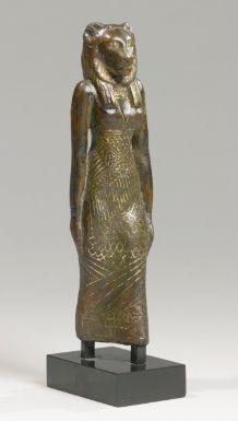 AN EGYPTIAN BRONZE FIGURE OF A LION-HEADED GODDESS, 21ST/22ND DYNASTY, 1075-716 B.C.