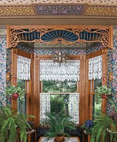 A fretwork spandrel by Cumberland Woodcraft demarcates the window bay in the newly added family room, where all surfaces are embellished with Victorian-era patterns. Ferns add to the Victorian air.