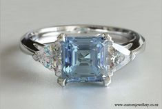 Square Emerald Aquamarine and Trillion Three-stone Engagement Ring New Zealand $5,530