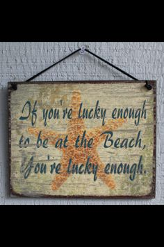 Lucky to be at the beach sign
