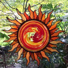 Stained glass sunburst - orange & white rays with swirled orange, yellow & clear center - Maid on the Moon Studio