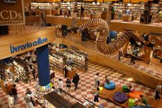 The Livraria Cultura in São Paulo, Brazil | Not only is this the largest bookstore in Brazil, but it's also a borderline playground for kids. There are massive dragon statues to play on, areas to lounge, and four stories of pure book-filled aisles to wander through.