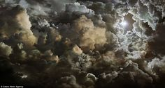 Contemporary art photographer Seb Janiak, from Paris, takes extremely high resolution shots of clouds before mixing them together to make works that appear almost celestial (Pictured: The Kingdom, Loi Spectrale Du Rayonnement 2011)