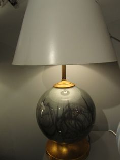 """""""The Gray Globe"""": pearl gray globe with charcoal abstract design. Brass details."""