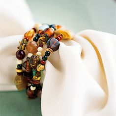 Beaded Ring: Though crafters may want to make their own beaded napkin rings, you can also look for hair baubles or wire bracelets that can be used as creative napkin rings. #DIY #crafts