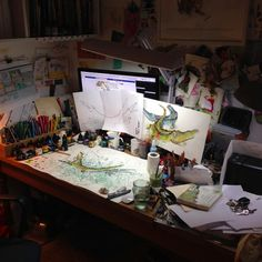 "Catherine Rayner's working space – ""This is my 'main desk' where I do most of my book work. On it is my computer and scanner. It's always covered in paper, sketchbooks and drawing stuff. Secretly, I prefer it when it's a mess, it's easier to find things that way!"""