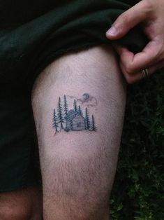 Here we have a great tattoo idea of a pretty simple and rather soothing view of a log house in the woods. There's also a moon and an outline of some clouds.