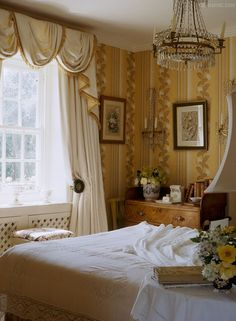 soft yellow and white English cottage bedroom with charming wallpaper