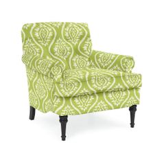 The Classic Club Chair in Mayan Ikat Kiwi, from Company C is a lovely way to bring in a bright pop of green to your living room.