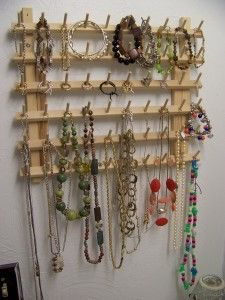 Wooden thread spool holder repurposed to a jewelry organizer