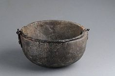 Viking age soapstone cauldron, Uppland. Round-bottomed vessels of soapstone; partially reconstructed. Hank and Hank mounts of iron.  In the Historiska Museet, Stockholm.