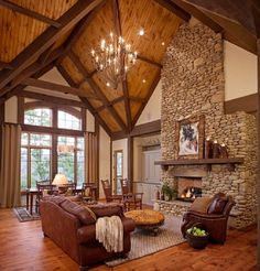 colors & Dark beams w/ honey colored tongue & groove plank ceiling. **** Living Room Ideas : Decorate Cabin Homes Living Room High Ceiling With Brown Leather Sofas Featuring Unique Bulb Chandelier And Stone Fireplace Fabulous Ideas to Decorate Living Room with High Ceiling High Ceiling Wall Ideas. Living Room Ceiling Pictures. Decorate Walls High Ceilings.