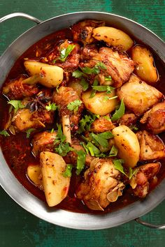 At Spicy Village in in Manhattan's Chinatown, the Spicy Big Tray Chicken arrives on an aluminum tray You eat it on a foam plate with a plastic fork or chopsticks It's a mound of chicken nearly afloat in a bath of dark, spicy sauce that contains star anise, Sichuan peppercorns, chile, garlic, cilantro, a few mystery ingredients and potatoes