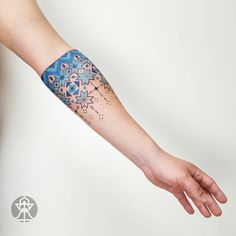 frozen blue geometric tattoo idea on the arm
