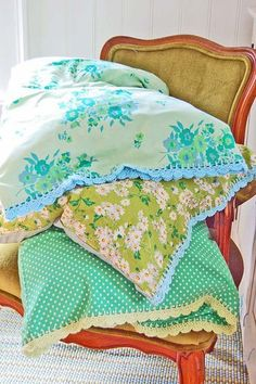 pillowcases with crocheted edging.