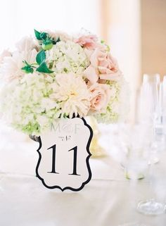 Pastel centerpiece with classic paper table number