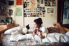 I'm surprised that I'm into this room's vibe, but it strikes me as cozy and eclectic. This could be me, minus the cat and with a bigger guitar.