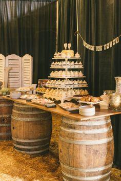 Barn Wedding Dessert Bar. Wine Barrels and wood top.