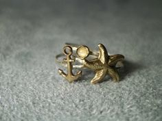 Stackable Sterling Silver Rings with Brass Anchor by fifthheaven