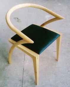 Asia Chair with upholstered seat.