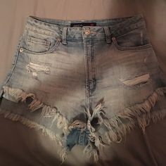 ON HOLD - NWOT JustUSA Shorts NWOT. Perfect condition distressed cutoff shorts. Size M. They're a little too big for me. Purchased at Beehive Boutique. Shorts Jean Shorts