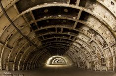 Hidden gems: A tunnel used for storage under Clapham North underground station in London> Mr Duncan said he found spaces like this 'totally unused and lonely'