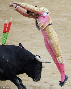 El Banderillero...one who inserts barbed wooden decorated sticks into the bull's neck muscles.