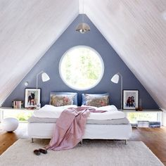 circle window! perfect opportunity for a circle bed! then u could put either polka dots on the wall to go along with the theme, or stripes to off set the pattern of polka dots and to be visually appealing.! :)
